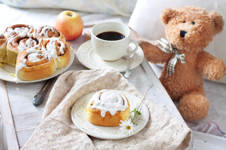 Cozy breakfast in bed - cinnamon rolls and coffee