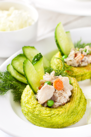 Nests made with duchess potatoes and peas stuffed with white fish ragout Reklamní fotografie - 66938997