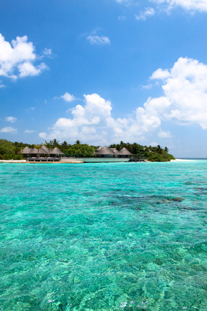 Turquoise lagoon and beach bungalows on Maldives Island