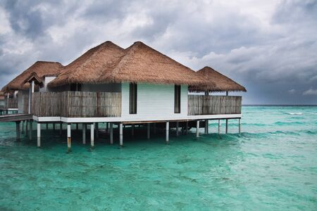 Water bungalows at rainy season. Storm in Maldives.