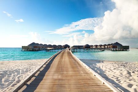 Water villas on Maldives island on a sunny morning Reklamní fotografie - 72165256