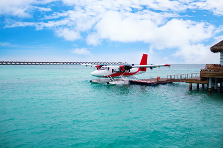 Sea plane of tropical Maldives island standing by the jetty.