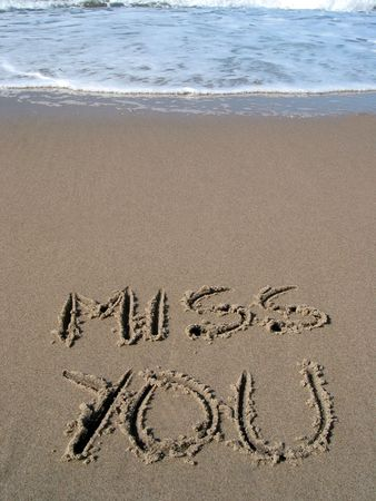 Words andamp,quot,Miss youandamp,quot, on the beach photo
