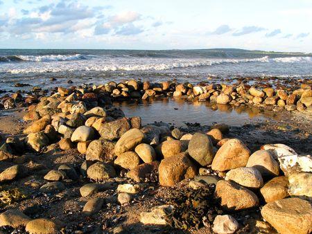nautic: Piled rocks on the beach