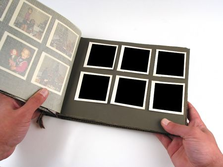 in insert: Close-up of old photo-album to insert your own images in (boxes are rectangular)