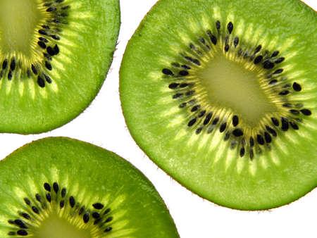 healthful: Aislado rebanadas de kiwi en fondo blanco  Foto de archivo