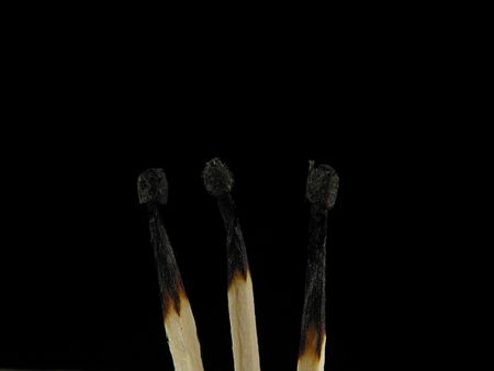 burned out: Three burned out matches... symbolic *hint* :-) Stock Photo