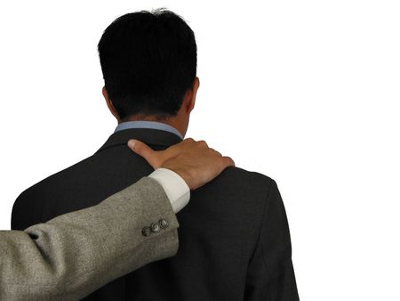 hand on shoulder: Business situation: one has gotten a bad news and his freind comforts him Stock Photo