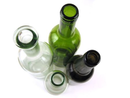 positioned: Four different glass bottles positioned on white background Stock Photo