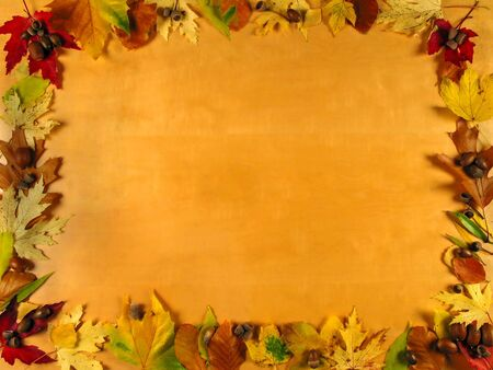Beautiful frame of autumn leafs on wood background, very warm photo