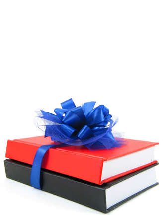Two books wrapped with a blue ribbon photo