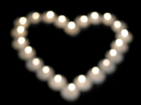 blurr: Full size blur of lights forming a heart on black background. Ideal as a background.