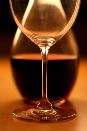 glas: Crop of a glas and wine on a wooden table, very warm feeling and beautiful details Stock Photo