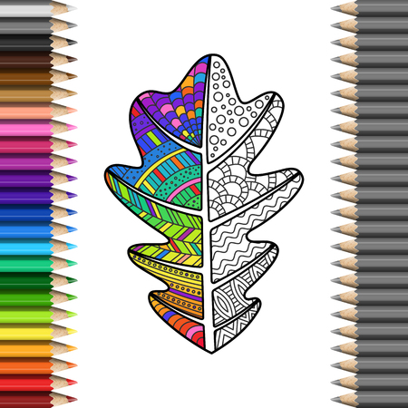 Handmade oak leaf with zentangle pattern in frame of colorful pencils.