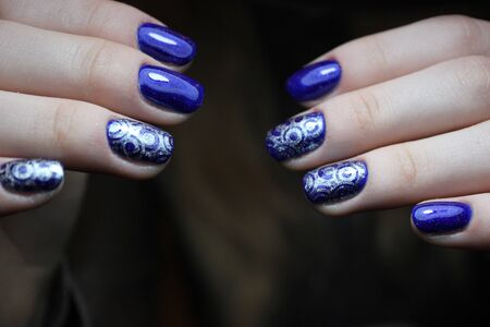 salon and spa: Blue manicure with silver pattern nails