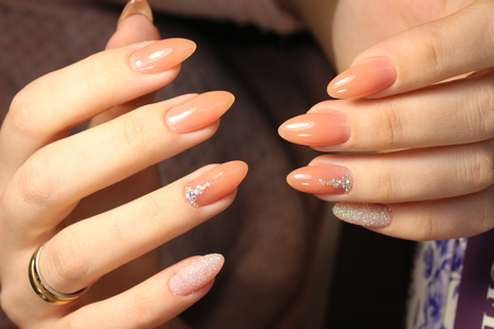 salon and spa: Manicure design of natural color on the exfoliated nails