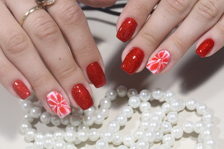 extensively: Manicure nails extensively bright red colors