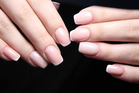 salon and spa: Beautiful gentle French manicure nails Stock Photo