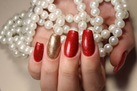 extensively: Manicure nails extensively bright red and gold