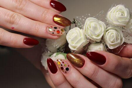 Manicure design Red glamor a beautiful pattern Reklamní fotografie