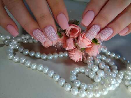 Delicate manicure of nails with decoration