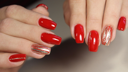 Nail Designs With Different Sequins On Red Nails For Stock Photo