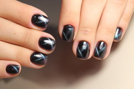 Hand on hand with nice manicure. Shellac complete Manicure process in salon nail salon.