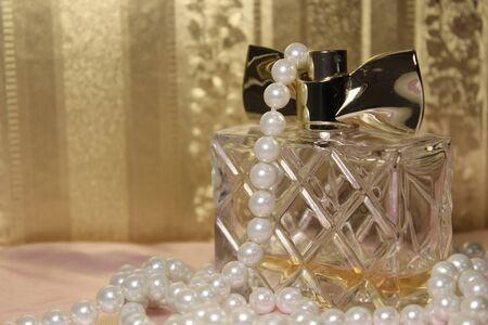 Perfume bottle on a beautiful background. Beauty