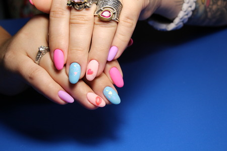 Closeup of woman hands with nail design. Trendy crackle nail polish. Manicure and nail tattoo trend. Stok Fotoğraf