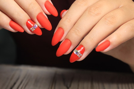 Closeup of woman hands with nail design. Trendy crackle nail polish. Manicure and nail tattoo trend. Closeup of woman hands on black background. Fashion Stylish Fashion Colorful Nails.