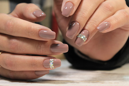 Amazing natural nails. Women's hands with clean manicure.