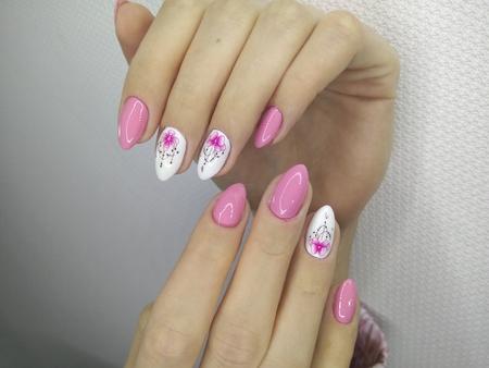 stylish design of manicure on long beautiful nails Reklamní fotografie - 121502337