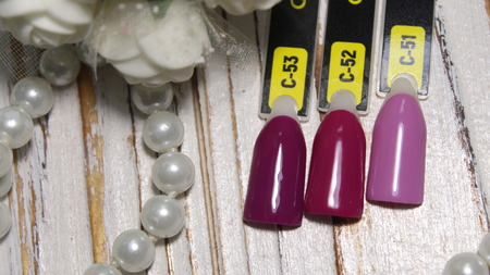 Nail polish swatches in different fashion color lacquer in tips. Color Stockfoto