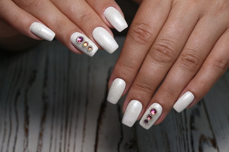 cropped view of female hands with nails Archivio Fotografico - 123591895