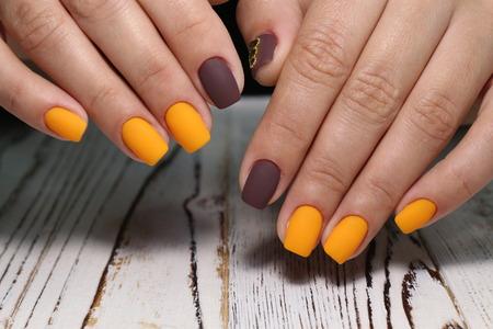 Multi-colored pastel manicure combined tone on tone with a striped background. Archivio Fotografico - 123591962