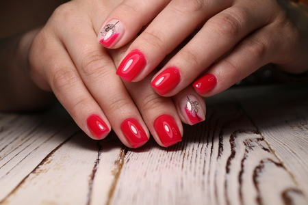 Multi-colored pastel manicure combined tone on tone with a striped background.