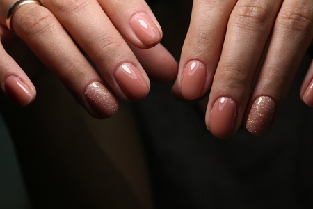 cropped view of female hands with nails