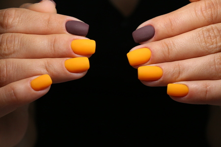 Multi-colored pastel manicure combined tone on tone with a striped background. Stock Photo - 123592086