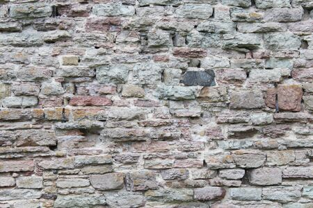 Brickwork, a beautiful wall. Interesting stone background 2019 Foto de archivo