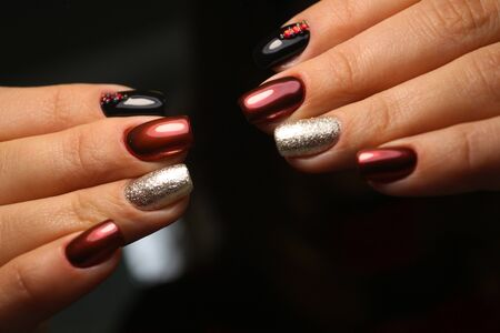 Beautiful groomed woman's hands. Nail varnishing in white color. Manicure, pedicure beauty salon