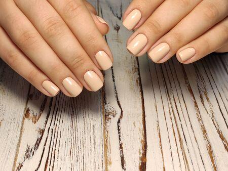 Perfect manicure gel art polish fashion design clean hand woman closeup on isolated background Zdjęcie Seryjne - 133077974