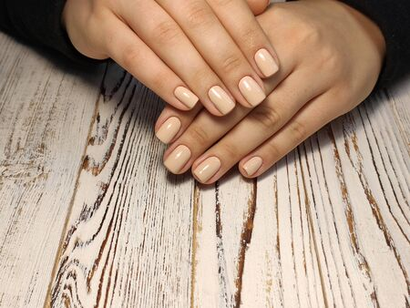 Hands Care. Hand With Pastel Nails In Sea Salt. Close Up Of Woman Hand With White Manicure In Pink Sea Salt. High Quality Image.