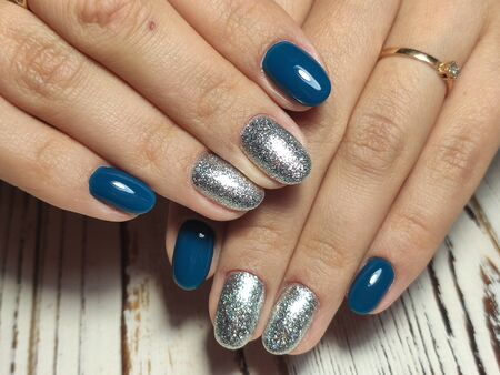 gel lacquer manicure on a textured trendy background Stok Fotoğraf - 134587658
