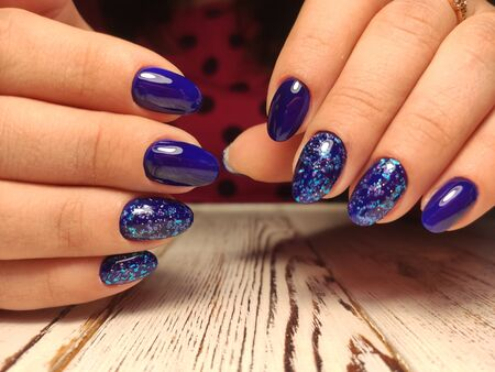 Bright neon manicure on female hands. Nail design. Beauty hands Imagens