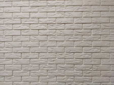 Modern white brick wall texture background for wallpaper and graphic web design. Reklamní fotografie - 134983754