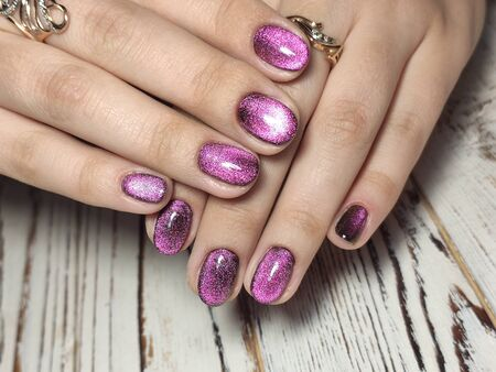Gray striped nail design on female hand close up 2019