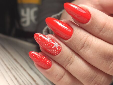 Beautiful womans nails with beautiful christmas manicure studio Stok Fotoğraf