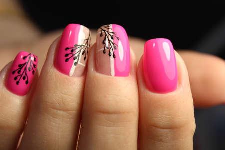 Trendy manicure design on a beautiful background.