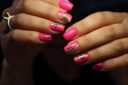 pink manicure on long beautiful nails