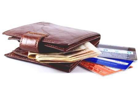 competency: Brown purse, money and credit cards on white background